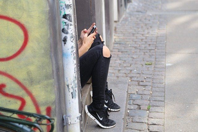 Teenager phone alone