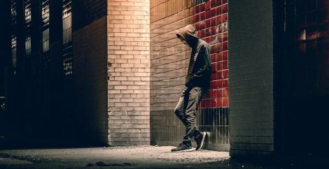Teenager leaning against wall