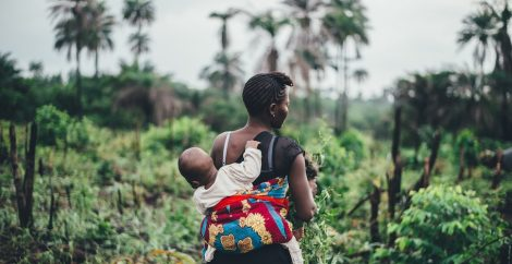 Mother with baby in tropics